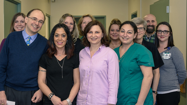 Several faculty and staff of the MSU Pediatrics and Human Development Division of General Pediatrics gathered in an MSU Clinical Center Hallway