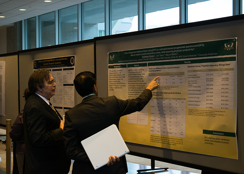 Dr. Ira Gewolb speaks with a conference attendee