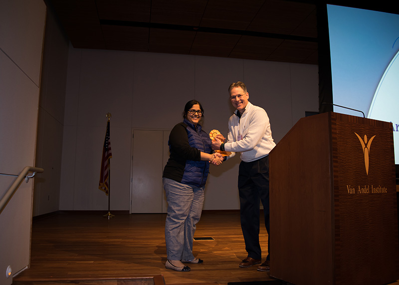 Suneeti Gupta, MD accepts her award from Brian Schutte, PhD