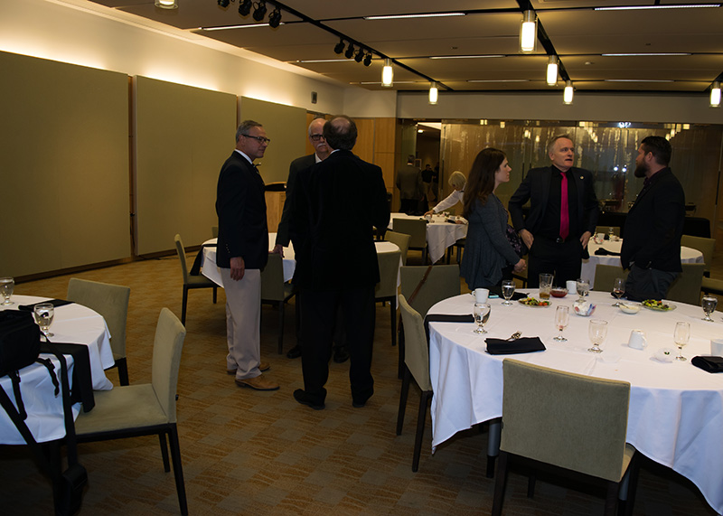 Faculty & guests meet for Dinner at the Secchia Center